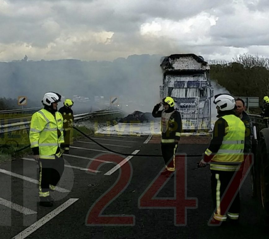 a303 closed in both directions after hay fire