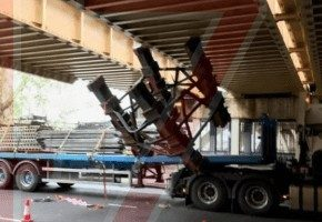 long delays after grab lorry malfunction and gets stuck under bridge