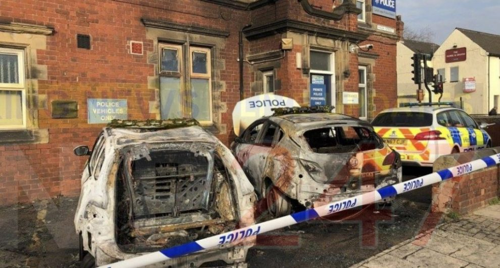 two arrested after arson attack on police cars