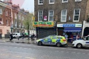 woman attacked with a machete on busy grays inn road in london