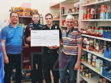 sussex police give donation to brighton food bank