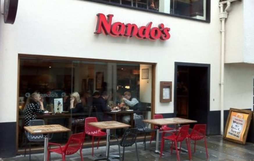 man arrested after teenager is attacked outside nandos in guildford