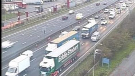 Car Leaves M25 Motorway And Comes To Rest In Tree Line
