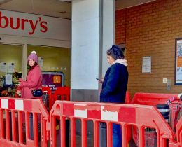 Social distancing queueing for the supermarket J Sainsburys north London Coronavirus Covid pandemic March